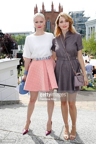 Franziska Knuppe and Eva Padberg attend the presentation of the Rauch Happy Day Limited Edition designed by Marina Hoermanseder ahead of the Marina...