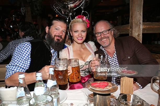 Franziska Knuppe and her husband Christian Moestl and Peter Olsson attend the Almauftrieb during the Oktoberfest 2015 at Kaeferschaenke beer tent on...