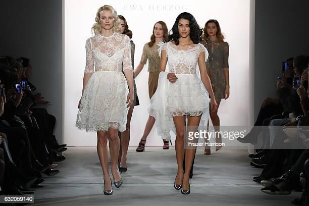 Franziska Knuppe and Rebecca Mir head models down the runway at the end of the Ewa Herzog show during the MercedesBenz Fashion Week Berlin A/W 2017...