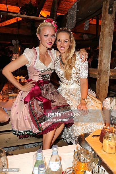 Franziska Knuppe and Sabine Lisicki attend the Almauftrieb during the Oktoberfest 2015 at Kaeferschaenke beer tent on September 20 2015 in Munich...