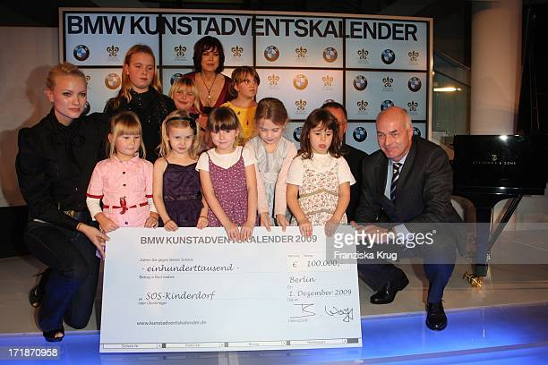 Franziska Knuppe, Anja Kruse And Karsten Engel with children from the SOS Childrens Villages at the opening Bmw Of Art Advent Calendar in Berlin