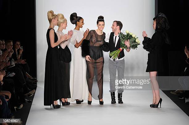 Franziska Knuppe Mandy Bork Sara Nuru and Barbara Meier congratulate designer Stephan Pelger at the Stephan Pelger Show during the Mercedes Benz...