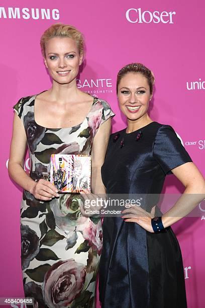 Franziska Knuppe Ruth Moschner with samsung handy attend the CLOSER Magazin Hosts SMILE Award 2014 at Hotel Vier Jahreszeiten on November 4 2014 in...