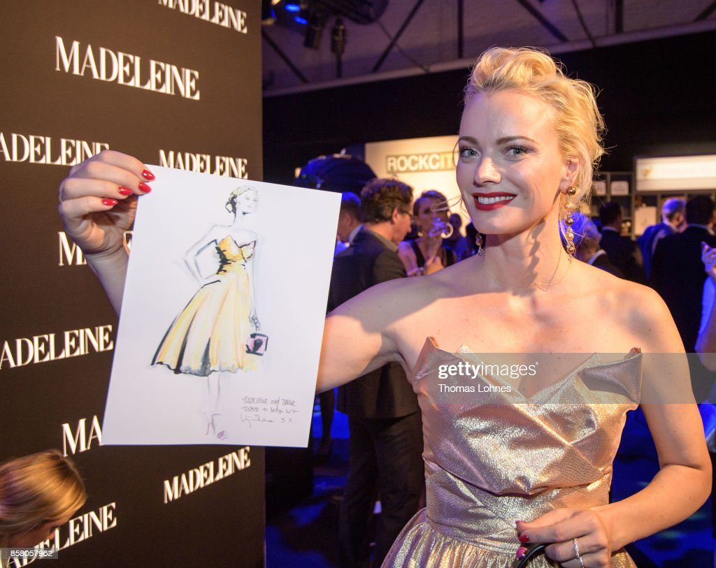 Franziska Knuppe shows her drawing made by Artist Virgina Romo during the Tribute To Bambi at Station on October 5, 2017 in Berlin, Germany.