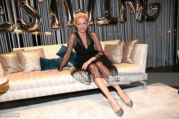 Franziska Knuppe wearing a dress by Escada and sits on a sofa during the 5th anniversary of Westwing on October 12 2016 in Munich Germany