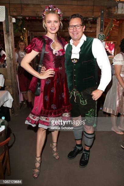 Franziska Knuppe wearing a red Dirndl by Lola Paltinger and Robert Poelzer Editor in chief of Bunte during the BUNTE Lunch at Oktoberfest 2018 at...