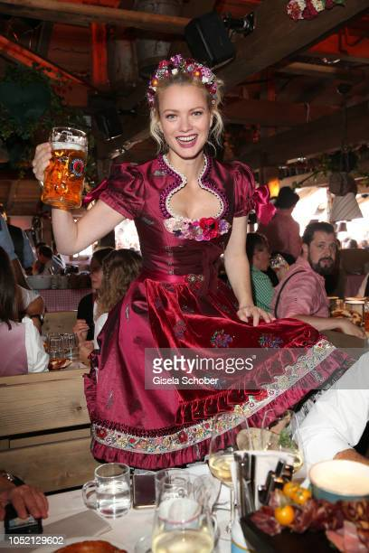 Franziska Knuppe wearing a red Dirndl by Lola Paltinger during the BUNTE Lunch at Oktoberfest 2018 at Kaeferschaenke tent / Theresienwiese on...