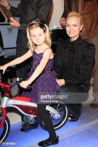 Franziska Knuppe With A Child From The SOS Childrens Villages at the opening Bmw Of Art Advent Calendar in Berlin