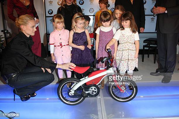 Franziska Knuppe with children from SOS Childrens Villages at the opening Bmw Of Art Advent Calendar in Berlin
