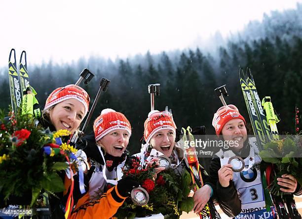Franziska Preuss Franziska Hildebrand Vanessa Hinz and Laura Dahlmeier of Germany celebrate third place in the IBU Biathlon World Cup Women's Relay...