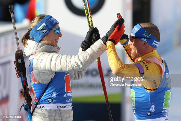Franziska Preuss of Germany an her team mate Erik Lesser celebrate after the Single Mixed Relay at the IBU World Championships Biathlon...