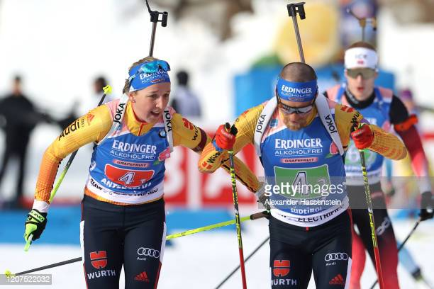 Franziska Preuss of Germany hands over to her team mate Erik Lesser during the Single Mixed Relay at the IBU World Championships Biathlon...