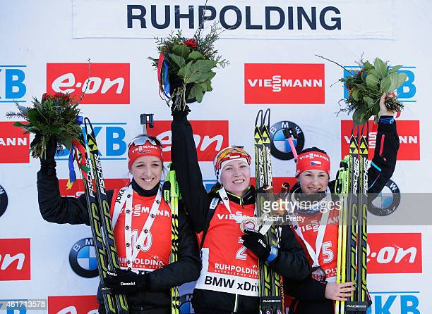 Franziska Preuss of Germany second place Darya Domracheva of Belarus first place and Veroknika Vitkova of the Czech Republic third place celebrate on...