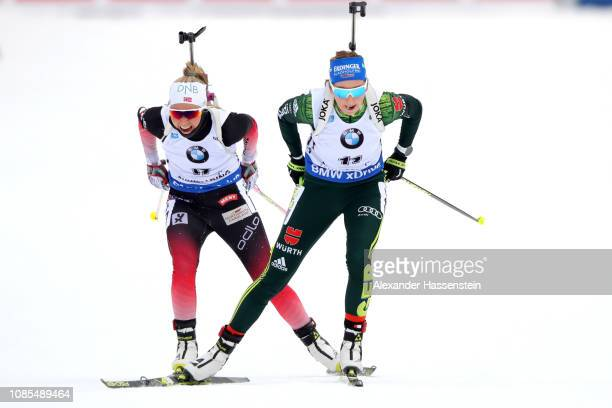 Franziska Preuss of Germany wins the Women 125 km Mass Start ahead of Ingrid Landmark Tandrevold of Norway during the IBU Biathlon World Cup at...