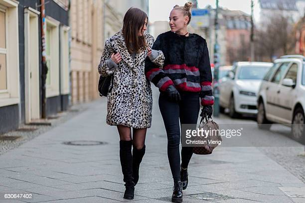 Franziska Radovanovic wearing a white leo print jacket tights black overknee boots and Denise Saidler wearing a fur jacket bun pigtails Louis Vuitton...