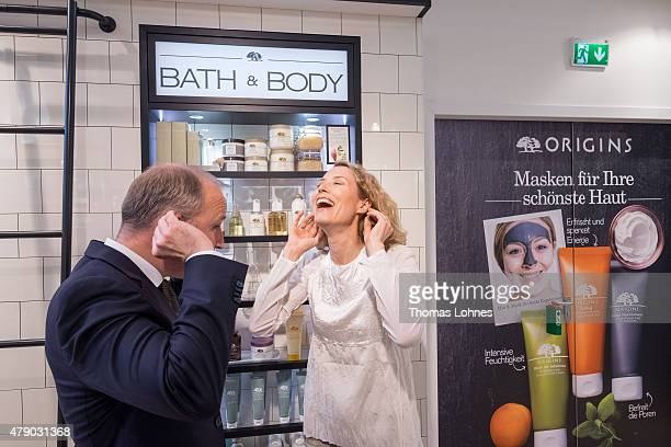 Franziska Reichenbacher and managing director of Origins Germany Markus Spieker test Origins products at the Origins flagship counter opening at...
