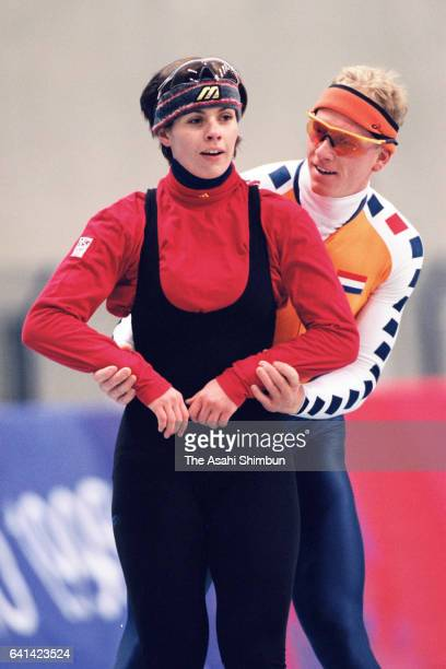 Franziska Schenk of Germany and Rintje Ritsma of the Netherlands talk during a practice session ahead of the Nagano Winter Olympic Games at Nagano...