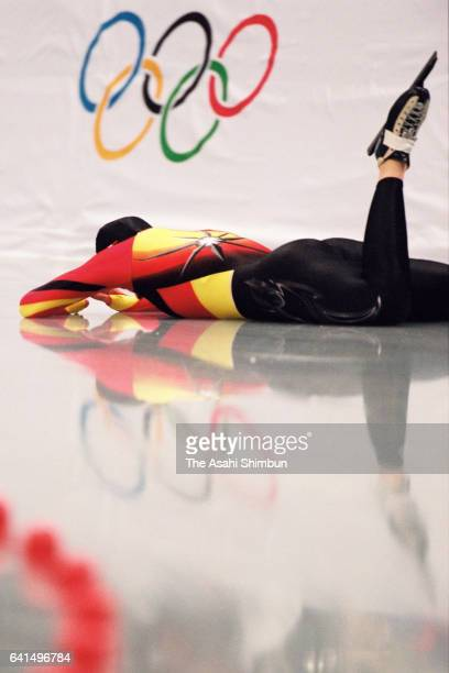 Franziska Schenk of Germany falls while competing in the Speed Skating Women's 1000m during day twelve of the Nagano Winter Olympic Games at M Wave...