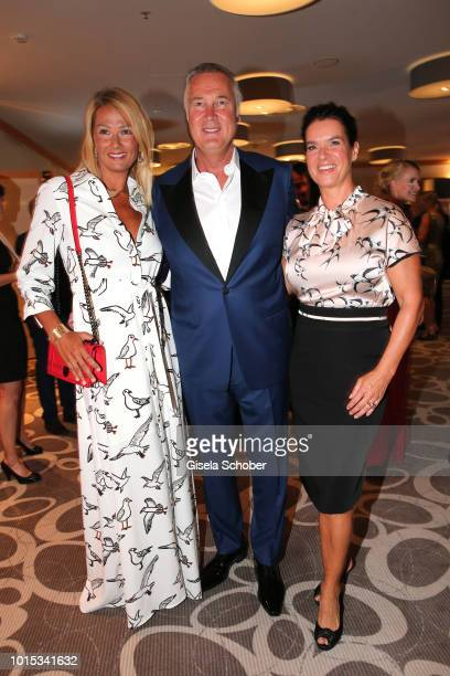 Franziska van Almsick her partner Juergen B Harder and Katarina Kati Witt during the 11th GRK Golf Charity Masters reception on August 11 2018 at The...