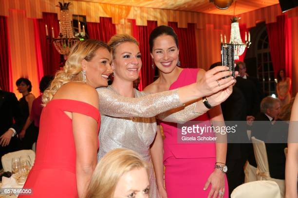 Franziska van Almsick Maria HoeflRiesch and Ana Ivanovic take a selfie during the Gala Spa Awards at Brenners ParkHotel Spa on March 25 2017 in...