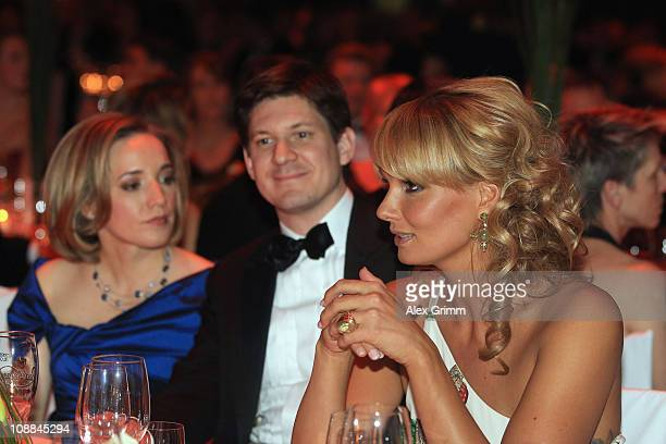 Franziska van Almsick Ole Schroeder and Germaan Family Minister Kristina Schroeder sit together during the 20011 Sports Gala 'Ball des Sports' at the...