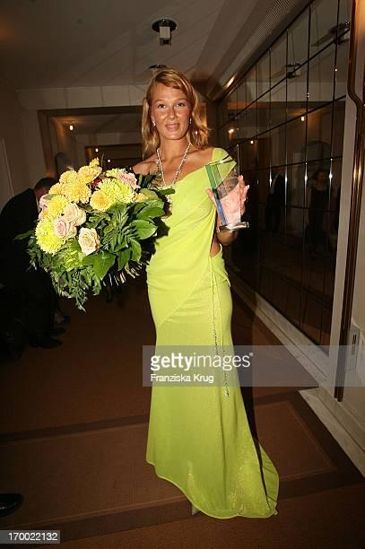Franziska Van Almsick with Armin Hary In 24th German Sports Press Ball In The Old Opera House in Frankfurt.