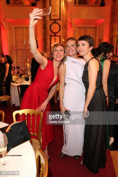 Franziska Weisz Patricia Aulitzky and Julia Koschitz take a selfie during the ROMY award at Hofburg Vienna on April 22 2017 in Vienna Austria