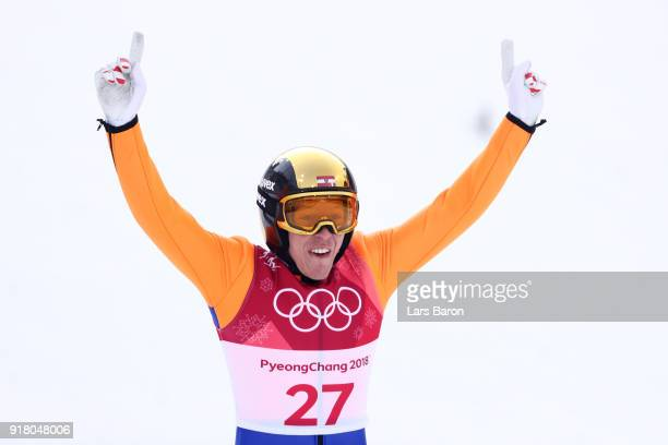 FranzJosef Rehrl of Austria reacts as he lands a jump during the Nordic Combined Individual Gundersen Normal Hill and 10km Cross Country on day five...