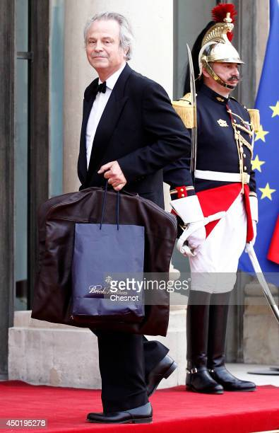 FranzOlivier Giesbert arrives at the Elysee Palace for a State dinner in honor of Queen Elizabeth II hosted by French President Francois Hollande as...
