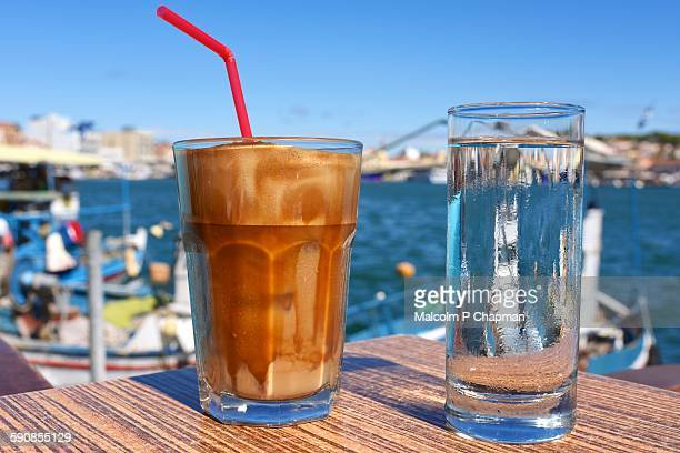 frappe coffee drink, mytilene harbour, lesvos - mytilene stock photos and pictures