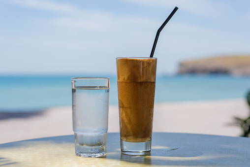 Frappe coffee drink served with a glass of water, Lesvos, Greece. - gettyimageskorea