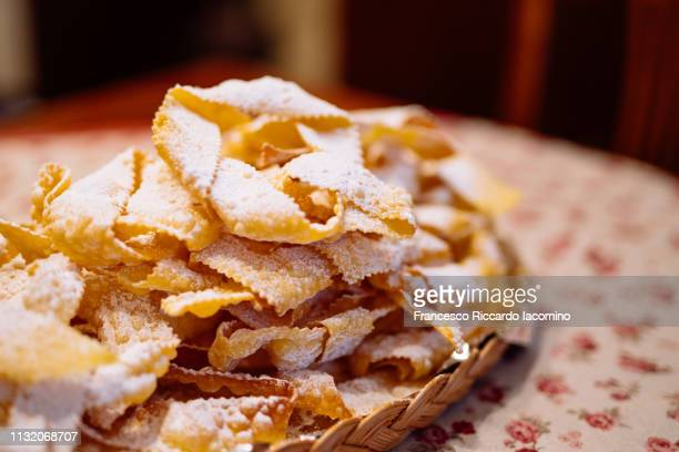 frappe, typical italian sweet fried pastry - modena stock pictures, royalty-free photos & images