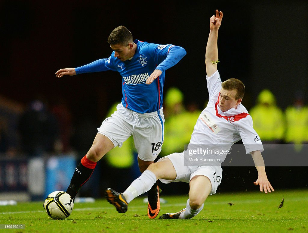 Fraser Aird (L) of Rangers vies with Liam Watt of Airdrieonians during the The William Hill Scottish Cup Third Round match between Rangers and Airdrieonians at Ibrox Stadium on November 1, 2013 in Glasgow, Scotland.