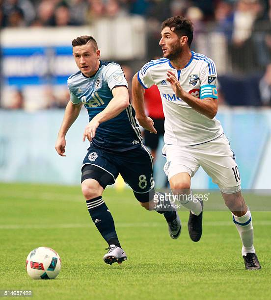 Fraser Aird of the Vancouver Whitecaps and Ignacio Piatti of the Montreal Impact chase a loose ball during their MLS game March 6 2016 at BC Place in...