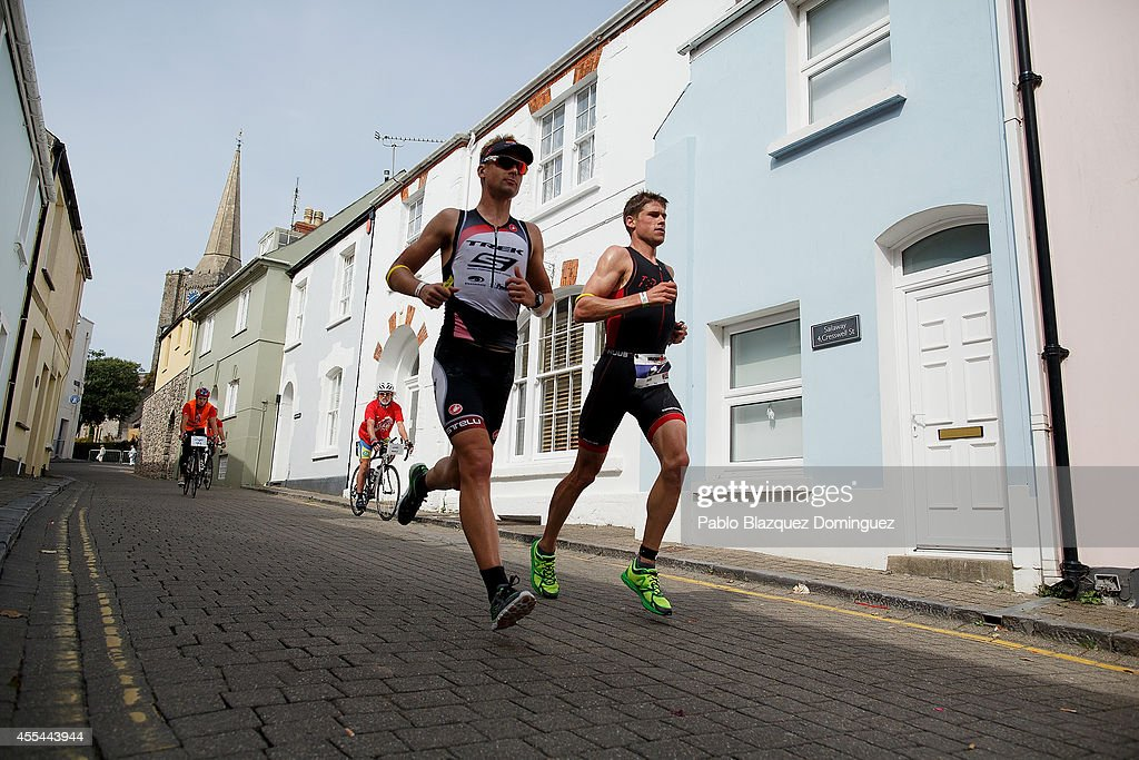 Fraser Cartmell (L) from Scotland and winner Matt Trautman (R) from South Africa compete in the run section in Ironman Wales on September 14, 2014 in Temby, Pembroke, Wales.