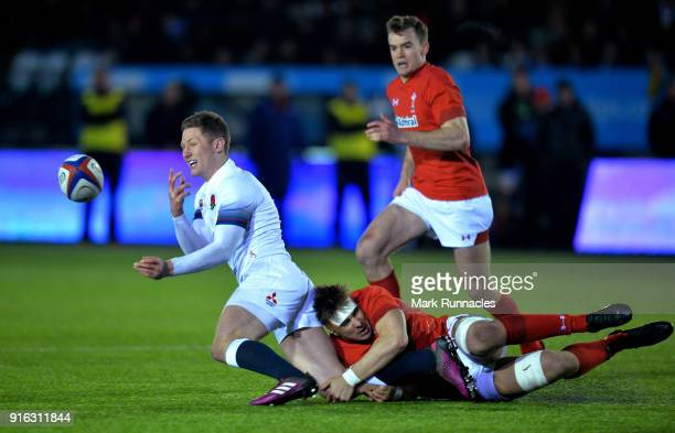 Fraser Dingwall of England is tackled by Taine Basham of Wales during the RBS Under 20's Six Nations match between England U20 and Wales U20 at...