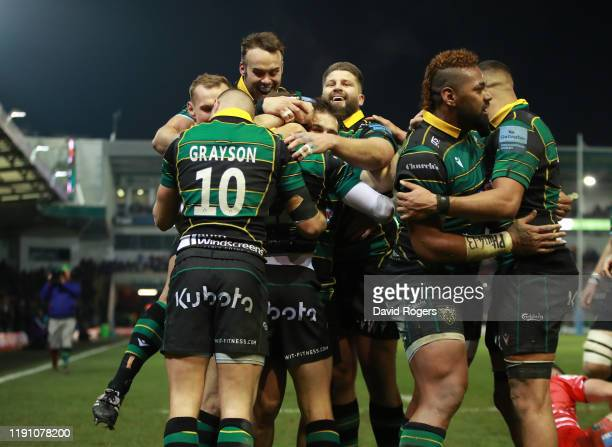 Fraser Dingwall of Northampton Saints celebrates with team mates after scoring a second half try during the Gallagher Premiership Rugby match between...