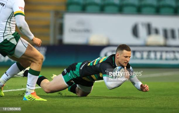 Fraser Dingwall of Northampton Saints dives over to score the first Saints try during the Gallagher Premiership Rugby match between Northampton...
