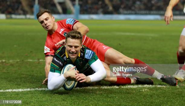 Fraser Dingwall of Northampton Saints scores a second half try despite being held by George Ford during the Gallagher Premiership Rugby match between...