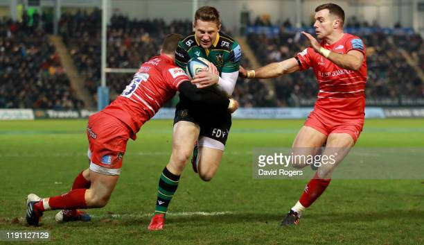 Fraser Dingwall of Northampton Saints scores a second half try despite being held by George Ford and George Worth during the Gallagher Premiership...