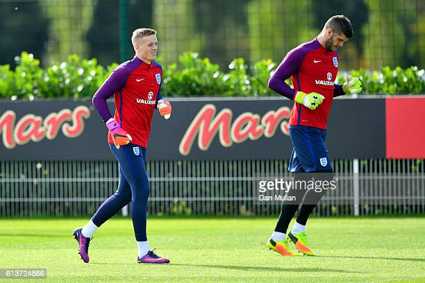 Fraser Forster and Jordan Pickford run during an England training session at the Tottenham Hotspur training ground on October 10 2016 in Enfield...