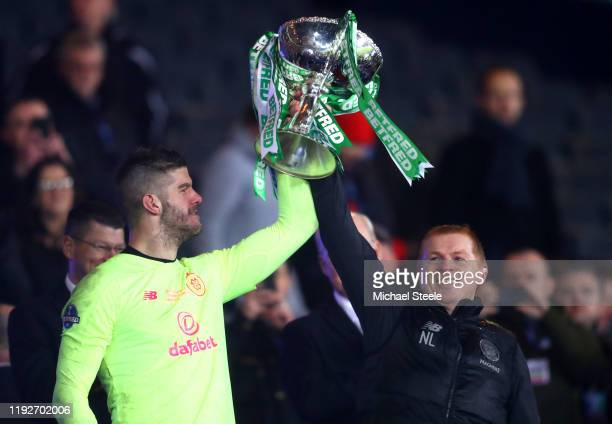 Fraser Forster of Celtic lifts the Betfred Cup with Neil Lennon Manager of Celtic after the Betfred Cup Final between Rangers FC and Celtic FC at...
