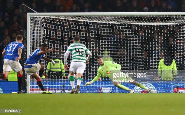Fraser Forster of Celtic saves a penalty from Alfredo Morelos of Rangers FC during the Betfred Cup Final between Rangers FC and Celtic FC at Hampden...