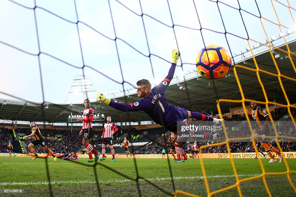 Fraser Forster of Southampton attempts to save as Robert Snodgrass of Hull City scores his sides first goal during the Premier League match between Hull City and Southampton at KC Stadium on November 6, 2016 in Hull, England.