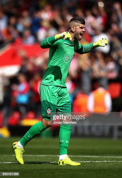 Fraser Forster of Southampton celebrates his sides first goal during the Premier League match between Southampton and West Ham United at St Mary's...
