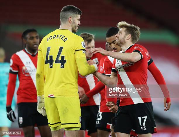 Fraser Forster of Southampton celebrates victory with Stuart Armstrong of Southampton after the Premier League match between Southampton and...