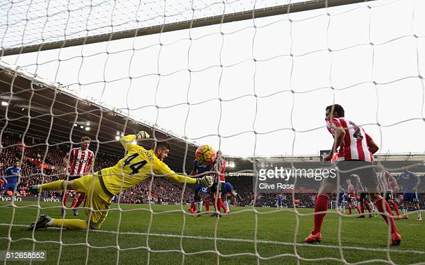 Fraser Forster of Southampton dives in vain as Branislav Ivanovic of Chelsea scores his team's second goal during the Barclays Premier League match...