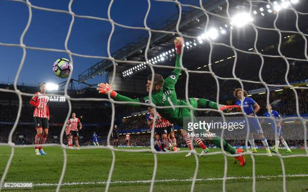 Fraser Forster of Southampton fails to stop Gary Cahill of Chelsea from scoring their second goal during the Premier League match between Chelsea and...
