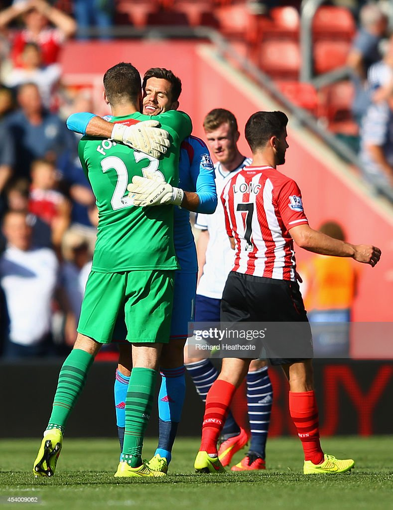 Fraser Forster of Southampton hugs Ben Foster of West Brom at the end of the match during the Barclays Premier League match between Southampton and West Bromwich Albion at St Mary's Stadium on August 23, 2014 in Southampton, England.
