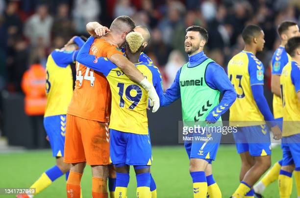 Fraser Forster of Southampton is congratulated by his team mates during the Carabao Cup Third Round match between Sheffield United and Southampton at...